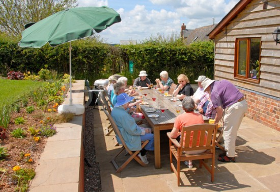 Elderly people eating outside