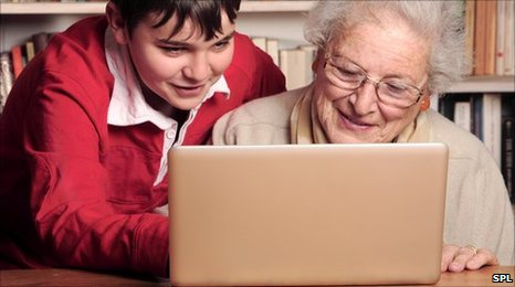 elderly_lady_learning_to_use_a_laptop