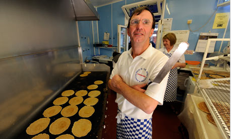 Owner Glenn Fowler bakes at the Hole In The Wall