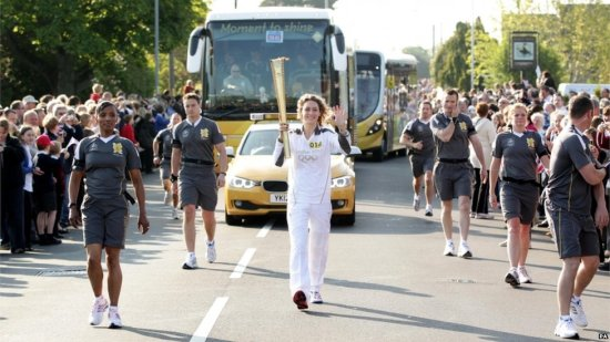 Amy Williams with Olympic Torch