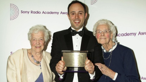 Beryl and Betty with David Reeves and their award