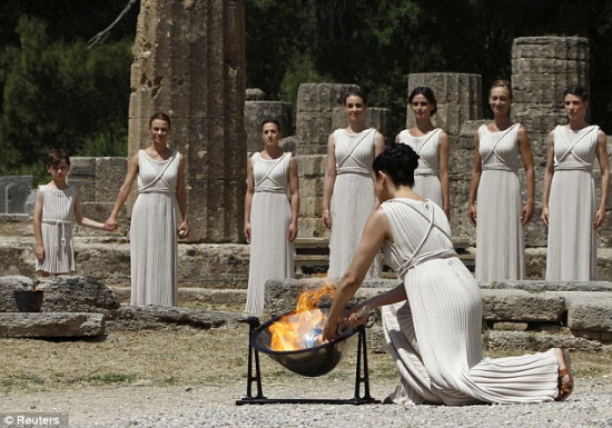 lighting the olympic flame in olympia