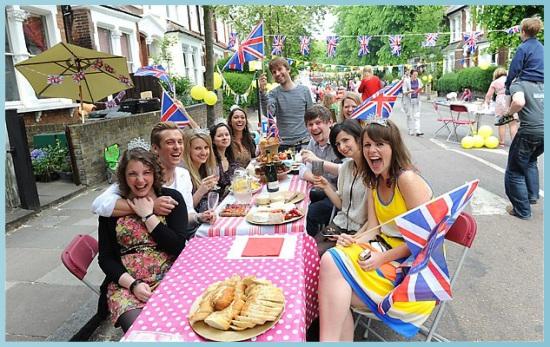 people enjoying streey party
