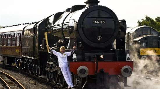 olympic torch on a steam train