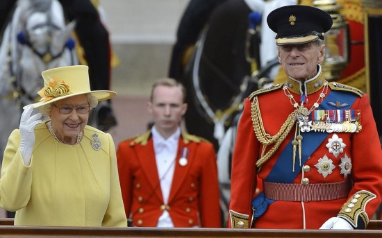 The Queen and Prince Phillip tropping the colour